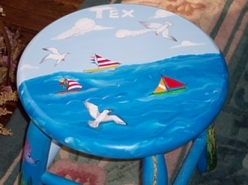 Hand Painted Rocking Chairs With Nautical Designs.